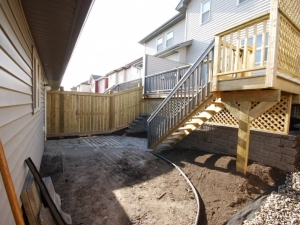 "By changing the orientation of the stairs and incorporating a ""Segmental Retaining Wall System"" we were able to increase the space in the otherwise ""dysfunctional"" back yard"