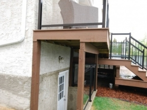 We incorporated a third deck level in order to create shelter for the basement walkout. The third level also provided our clients with a much improved view of downtown Edmonton