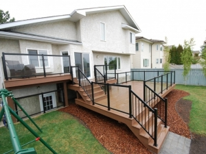 "This custom (3 Tiered) Composite Deck was complimented with a ""Black Aluminum & Tempered Glass Handrail System"""