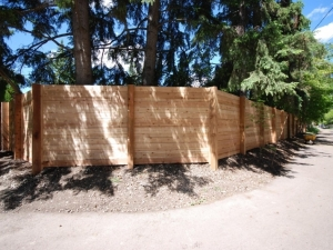 "Another look at our ""Crestwood"" Custom Cedar Fence project. Notice how we incorporated a ""liner"" look by fastening the boards ""horizontal"" instead of ""vertical""?"