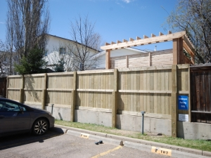 This particular fence proved challenging as it had to be constructed on a pre-existing concrete retaining wall