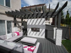 "This landscape revitalization project in Leger included an amazing ""Composite Deck & Pergola"" with a cozy ""Gas Fireplace"""