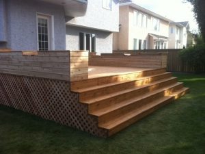 "A Custom ""Cedar Deck"" with Full Length Stairs and ""Built-In Flower Boxes"" replaced the old deck at this ""Brookview"" project"