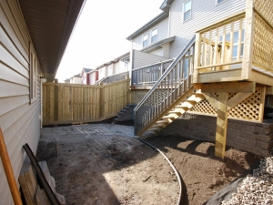 """By changing the orientation of the stairs and incorporating a """"Segmental Retaining Wall System"""" we were able to increase the space in the otherwise """"dysfunctional"""" back yard"""