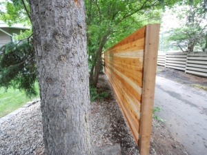 """The Cedar Fence Boards were installed in the """"horizontal"""" position compared to the traditional """"vertical"""" position. This provided the fence with more of a """"Custom"""" look"""