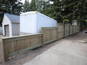 We elected to tier this section of the fence in order to improve visibility for our clients when backing into the alley
