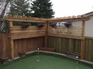 """We constructed an (L-Shaped) """"Arbor"""" at our """"Ramsey Heights"""" project in order to create privacy from the condominiums behind. It also served as a great place to hang some beautiful baskets!"""