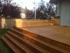 """Another look at our """"Custom built Cedar Deck"""" in """"Brookview"""" with built-in planters and seats"""