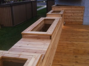 """Custom Cedar Deck c/w Built-In Planters & Seats. We incorporated a """"weeping tile drainage system"""" in the planters in order to control the moisture level of the soil"""