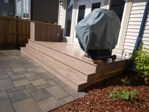 """A small (but functional) """"Composite Landing"""" was constructed in order to provide access from the house to the Patio area. It also provided a great place for the Bar-B-Que to sit"""