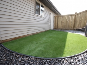 """Artificial Turf. If you are looking for a """"Low Maintenance"""" yard, this is definitely the way to go! This particular project consisted of utilizing """"Sierra Pacific - Artificial Turf by """"Bella Turf"""". Given that our client had a dog, we recommended utilizing """"ZeoFill"""" as the """"Infill Product"""". This particular product is """"100% Naturally Organic"""", it's """"Child & Pet Friendly"""" it reduces unwanted """"Odor"""" and acts as a """"Deodorizer"""". It's definitely the way to go if you want to maintain a """"green and lush lawn""""... and spoil your pooch in the process!"""