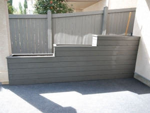 """The """"Tiered Planter"""" was constructed in order to hide an (ugly) concrete """"wing wall"""" that extended out from the house"""