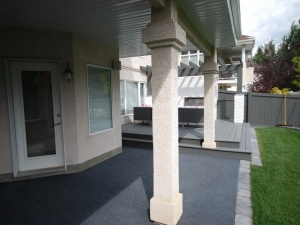 """Outdoor carpet was installed in order to create a """"warmer"""" and """"enhanced"""" look compared to what the """"broom finished"""" concrete offered before"""
