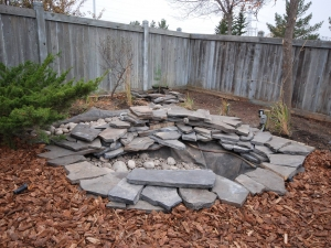 """Black Rundle (natural stone) Water Feature c/w 60mm to 80mm Athabasca River Rock assisted in creating that """"Natural Riverbed"""" look"""
