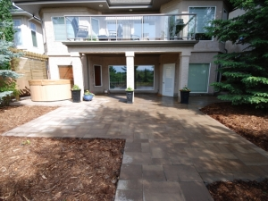 """Extensive use of """"Blu 60mm (smooth) Paving Slabs by Techo-Bloc"""" at this """"Hodgson"""" walk-out landscape revitalization project"""