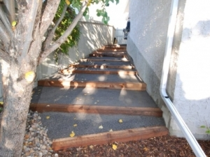 """Custom Built (Cedar & 10mm Limestone) Steps were incorporated down the side off this walkout lot in """"Leger"""""""