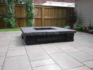 """A """"Graphix (Onyx Black) Fireplace"""" by """"Techo-Bloc"""" was constructed and really complimented the Patio area of the """"Allendale"""" (infill) project"""