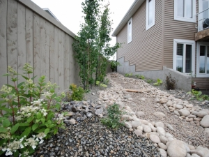"""A """"Dry River Bed"""" was incorporated down the side of this """"Starling at Big Lakes"""" walkout lot"""