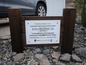 """Our custom (cedar) sign makes a solid statement with respect to the """"quality"""" work OutdoorSpace provides its valued clients"""