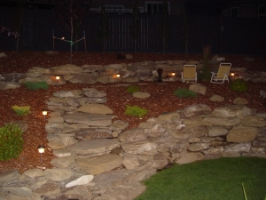 """Incorporation of a """"Low Voltage Lighting System"""" really brought this yard and the Natural Stone Retaining Walls to life after the sun went down"""