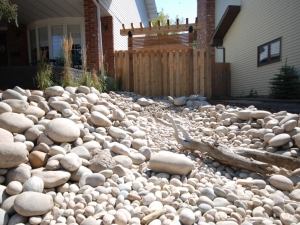 """Another look at the """"Dry River Bed'. We utilized """"Athabasca River Rock"""" in order to create this beautiful """"one of a kind"""" landscape feature"""