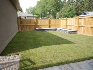 """We utilized """"Graphix by Techo-Bloc (Onyx Black)"""" pre-cast wall stones to create a raised vegetable garden in this urban back yard"""