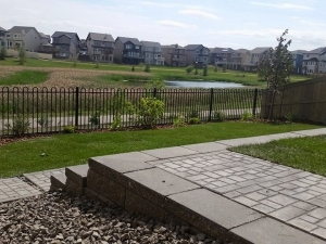"""Incorporating a """"Segmental Retaining Wall System"""" really improved the """"functionality"""" of this walk-out lot in Glenridding"""