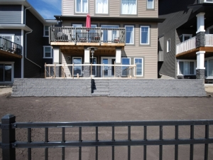 """We constructed a """"Segmental Retaining Wall System"""" in order to create more """"usable space"""" in the rear yard. The Retaining Wall was constructed utilizing """"Pisa 2 Blocks by Expocrete"""""""