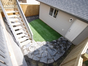 """A """"Birds Eye View"""" the back yard of this townhouse in """"Walker Lakes"""" showcases the """"Artificial Turf"""" and """"Flagstone Pathway"""""""