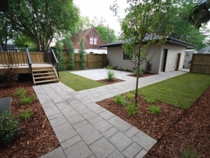 """As a result of the """"modern"""" look of this particular property, we elected to incorporate a """"Linear"""" design to the landscaping of this particular Allendale (infill) project"""