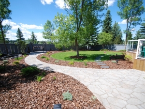 """This particular Patio & Sidewalk was constructed using """"Mega-Libre (Toscana) Slab"""" by Belgard"""