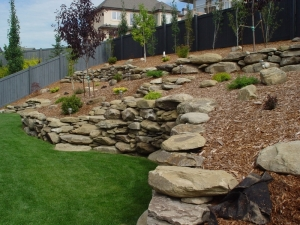 """Another look at the """"Tiered Sandstone Retaining Wall"""" at our """"Citadel at Magrath"""" landscaping project"""