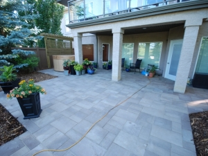 """We removed the old """"Roman Pavers"""" due to poor construction and replaced them with """"Blu 60mm (smooth) Pavers by Techo-Bloc"""" at this Hodgson landscape revitalization project"""