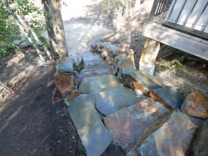 """Due to the difference in elevation from the deck to the lake front, we elected to construct a set of access steps utilizing """"Natural (Kendall) Stone"""". You won't find another set of steps that look this COOL!"""