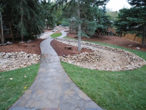 """This photo of our Hastings Lake project really showcases the extensive Sidewalks that were constructed and how they intertwine with the """"Dry River Bed"""""""