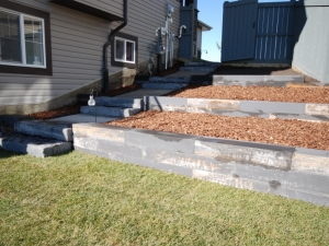 """We incorporated a multi-level """"Segmental Retaining Wall System"""" in order to create a """"terracing"""" effect and provide our client with safer access to their back yard"""
