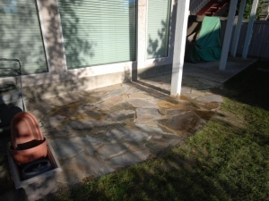 """A """"Bronze (natural stone) Flagstone Patio"""" was constructed underneath the deck in order to create more usable... OutdoorSpace"""