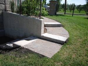 """We incorporated """"Mega-Libre (Toscana) Slab by Belgard"""" and """"Pre-Cast Dimensional Steps"""" by barkman in order to navigate down to this walk-out lot in Hodgson"""