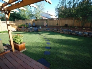 """A """"Natural (Kendall) Dry Stack Stone Retaining Wall"""" was incorporated in this (Blue Quill) back yard in order to increase the """"usable"""" OutdoorSpace"""