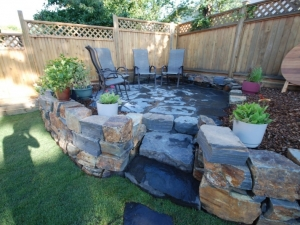"""This """"Kendall (natural stone) Retaining Wall"""" transformed the yard and added a ton of extra (usable) space. Eleven truck loads of clay/soil were removed in order to transform this OutdoorSpace"""