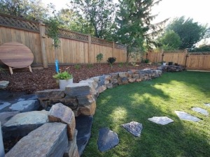 """Another look of the """"Natural Stone Retaining Wall"""" we constructed at our """"Blue Quill"""" landscape revitalization project"""