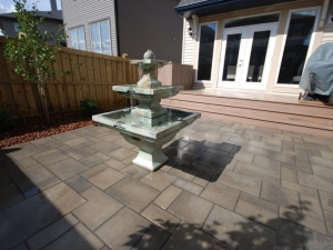"""A """"Pre-Cast Concrete Water Fountain"""" really improved the overall """"OutdoorSpace"""" experience at this """"Ambleside"""" back yard"""