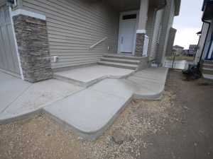 In order to gain access to this walk out lot in Windermere we elected to use concrete in order to tie it in with the existing sidewalk and steps