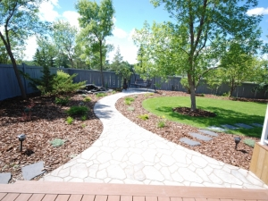 "We incorporated ""Mega-Libre (Toscana) Slab"" by Belgard at this ""Ogilvie Ridge"" landscape revitalization project"