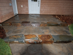 "We utilized Natural (Kendall) Stone in order to create a step. The Steps and Landing were fairly ""labour intensive"" to construct, but it turned out real NICE!"