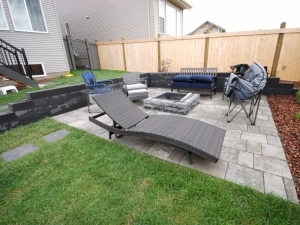 "We incorporated a ""Architextures Wall"" in order to create a ""sunken"" Patio/Firepit area at this ""Hawks Ridge Landing"" project"