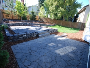 "Both Patios were constructed using ""Mega-Libre (Charcoal) Slab "" by Belgard"