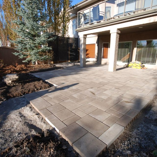 grading a yard - grading around house - lot grading - grading yard - grading yard for drainage - leveling a backyard - yard grading services - landscaping and grading